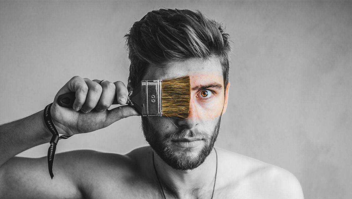 gray-scale-photo-of-man-holding-brush-2889359