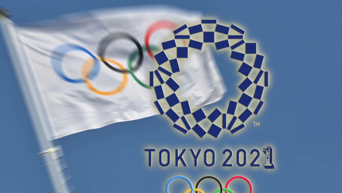 FOTOMONTAGE: Olympische Spiele sollen am 23.Juli 2021 eroeffnet werden. Archivfoto;Olympische Flagge,Olympiaringe,Fahne