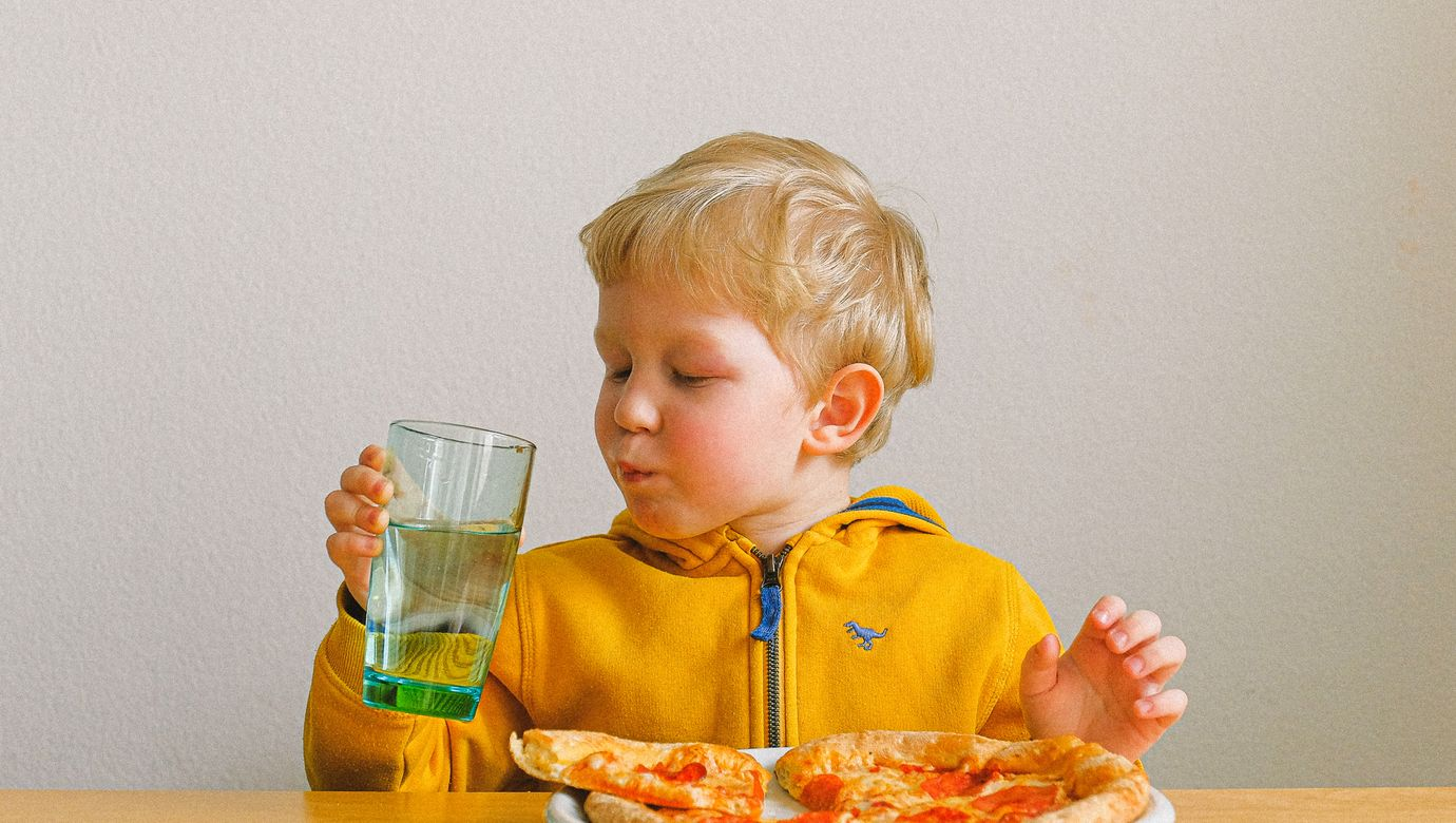 boy-holding-clear-drinking-glass-3905789