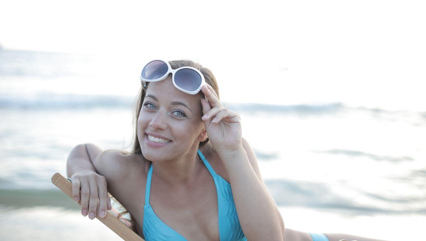 woman-in-blue-bikini-top-wearing-white-framed-sunglasses-3813725