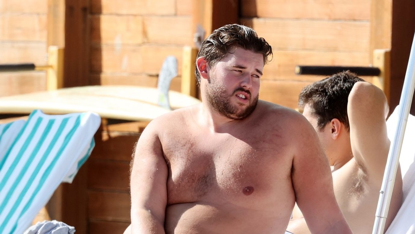Patrick Schwarzenegger and brother Christopher Schwarzenegger show off their abs on the beach in Santa Barbara