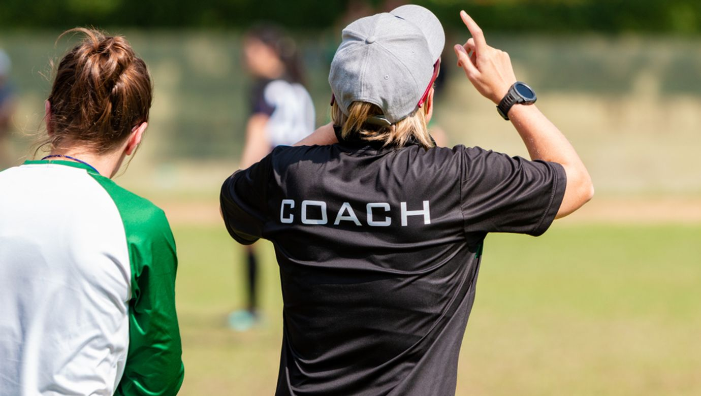 Back,View,Of,A,Female,Soccer,,Football,,Coach,In,Black