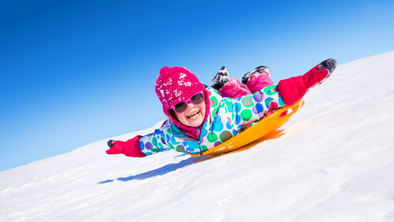 Little,Girl,Riding,On,Snow,Slides,In,Winter,Time