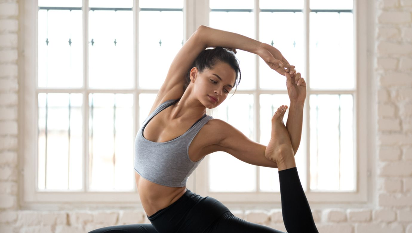 Young,Sporty,Attractive,Woman,Practicing,Yoga,,Doing,Mermaid,Exercise,,Eka