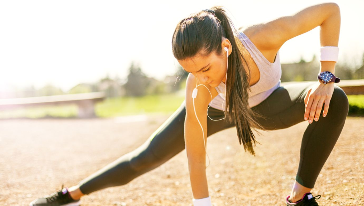 Young,Sportswoman,Stretching,And,Preparing,To,Run.