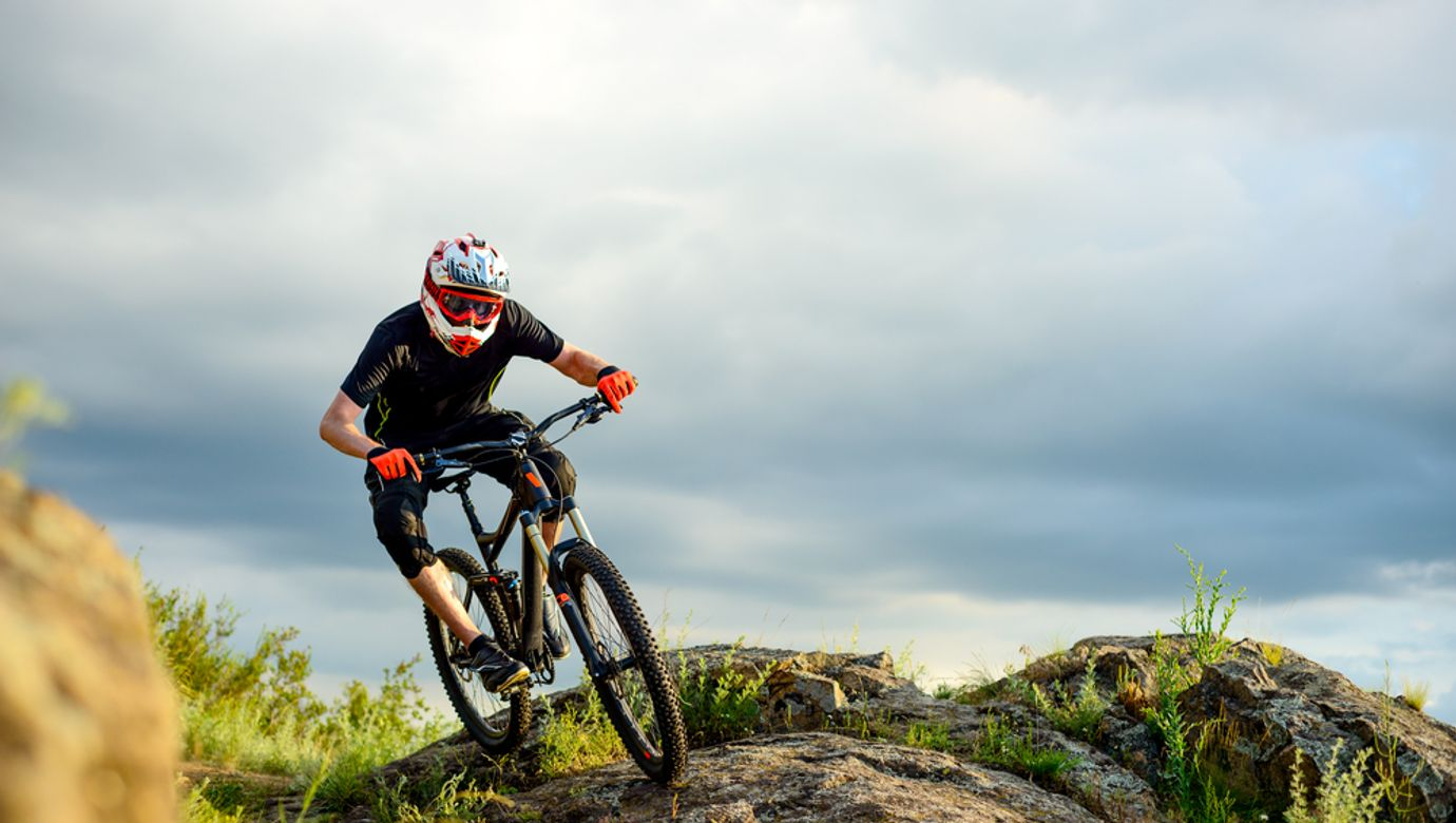 Professional,Cyclist,Riding,The,Bike,On,The,Rocky,Trail.,Extreme