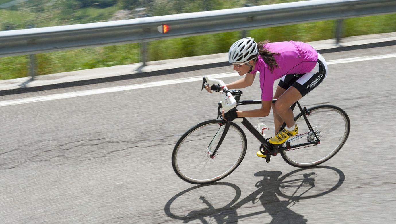 Woman,Race,Biker,By,Road,Cycling,Downhill,-,Portrait